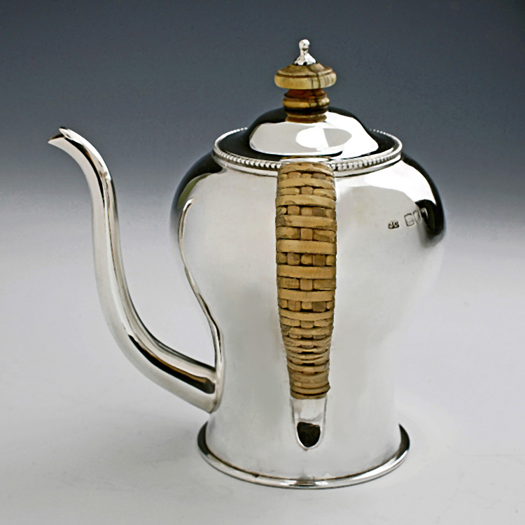 Silver argyle argyll showing cane wrapped handle and spout