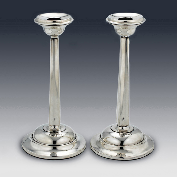 Pair of sterling silver candlesticks by Edwardian Reynolds and Westwood