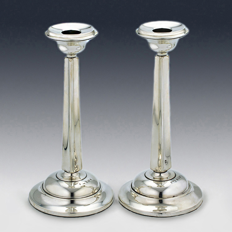 Pair of tapered convex sterling silver matched candlesticks