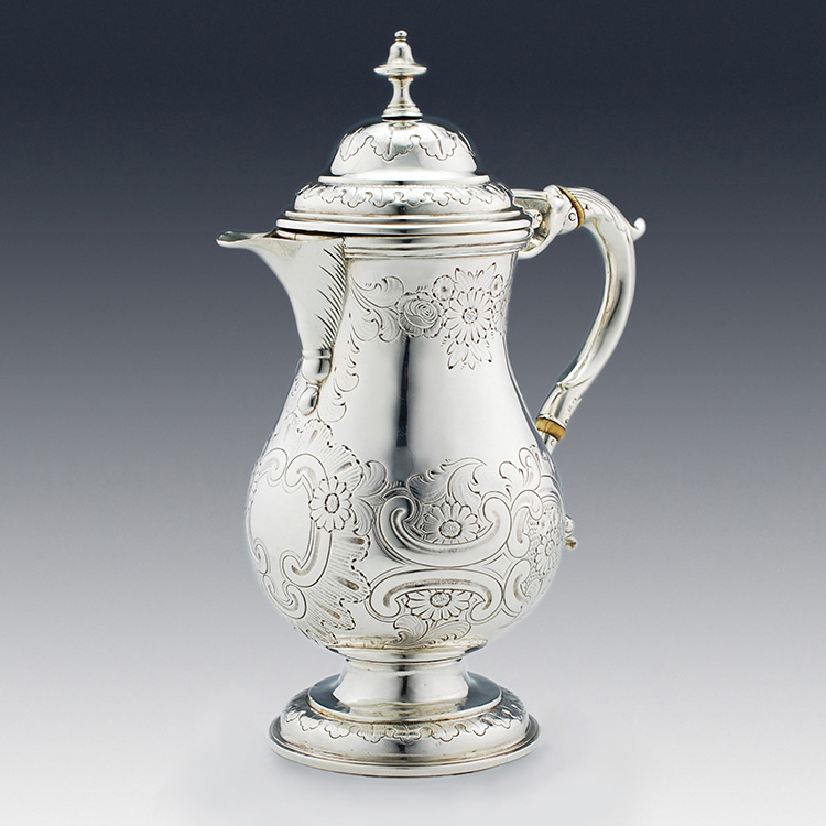 Side profile of arts and crafts silver coffee pot