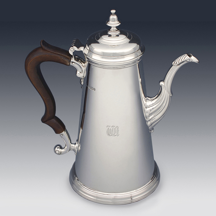 Side profile showing cylindrical tapered design of the coffee pot