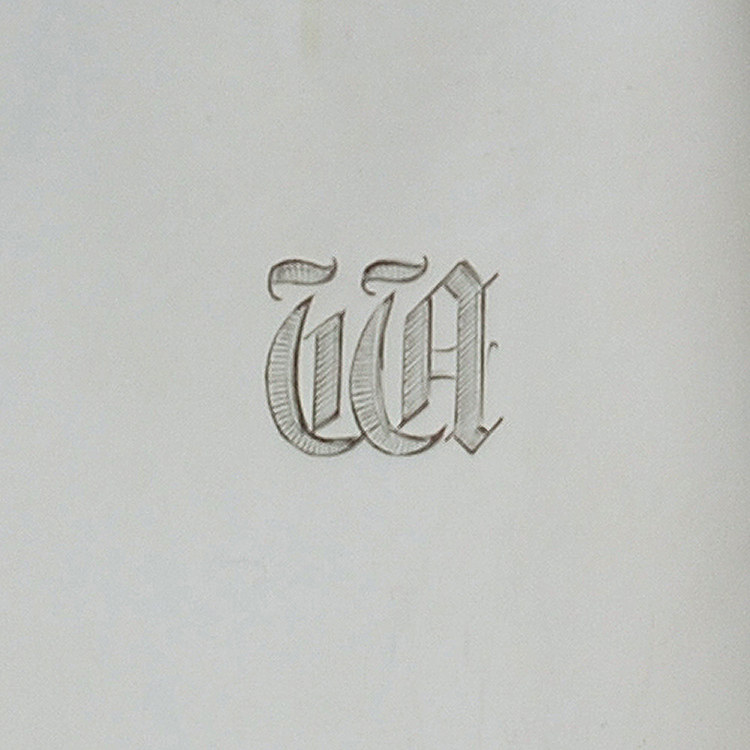 Close up of engrave d initials to silver coffee pot