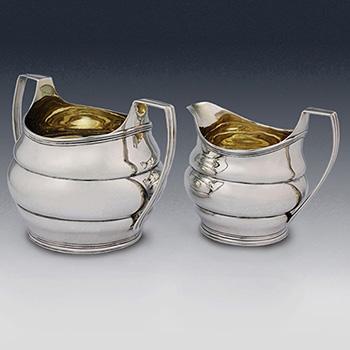 Antique sterling silver cream jugs and sugar bowls